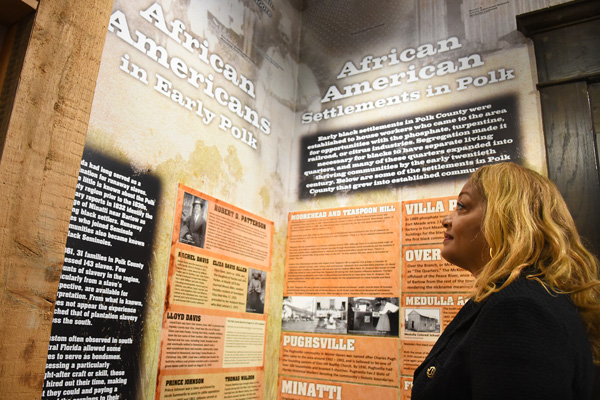 Polk County Historical Commission member Jan Parham visits the History Center to explore some of the guide's features, which include the early black settlements of Pughsville and Florence Villa, local athletes, judges and soldiers.